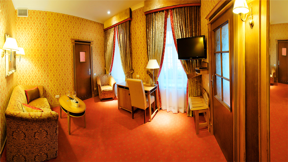 swiss hotel lux suite living room 2Отель Швейцарский